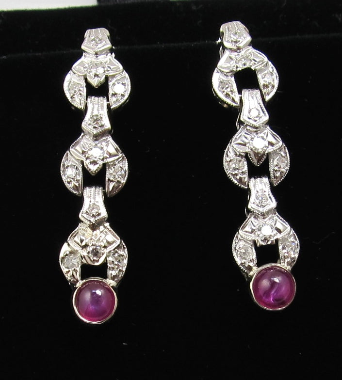 Vintage platinum drop earrings with diamonds and star ruby