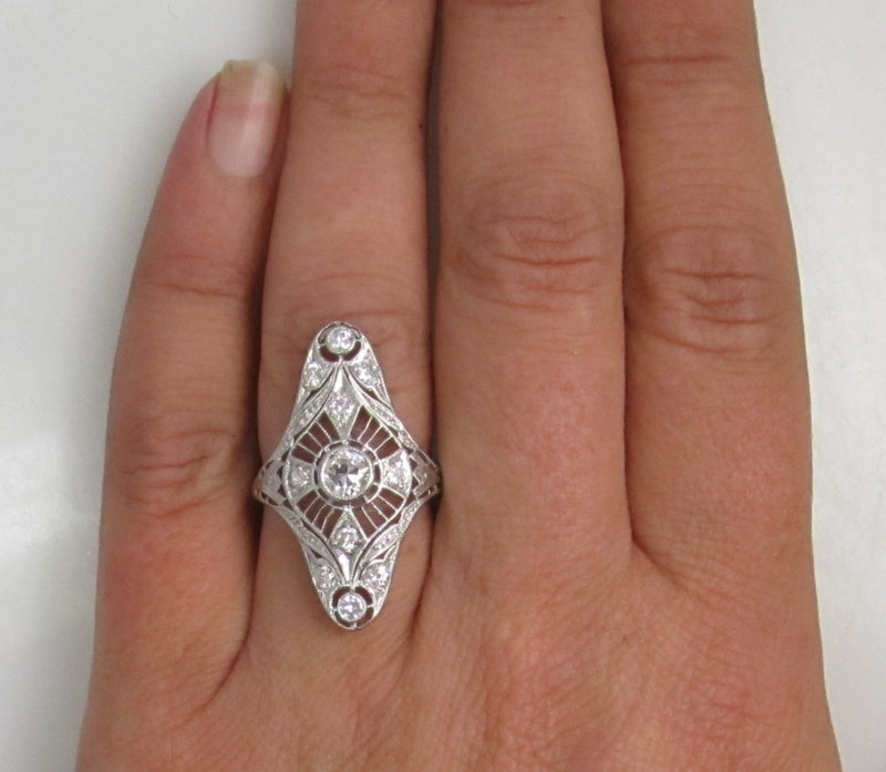 14k white gold filigree ring with 1ct TW in OEC diamonds, SI1 F-G, circa 1920