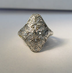 Long antique filigree diamond pinky ring in platinum