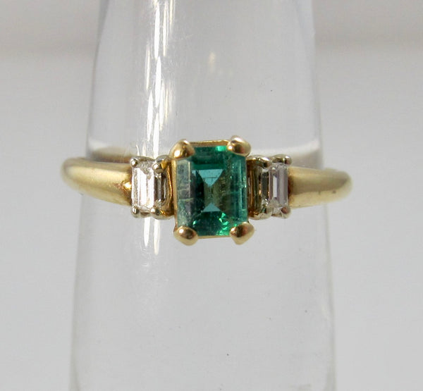Pretty emerald and diamond ring