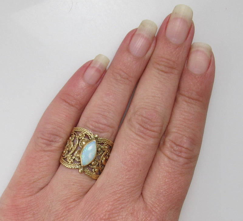 Wide cigar band opal ring