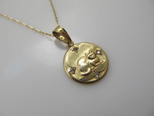 Yellow gold diamond cat necklace