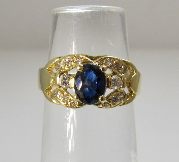 Yellow gold sapphire and diamond ring