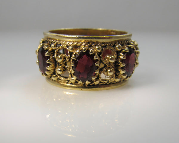 Wide garnet eternity band in 14k yellow gold, size 9 1/2