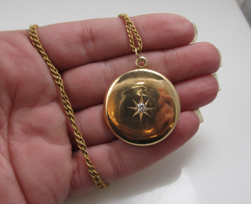 Antique 14k rose gold locket with a star set diamond