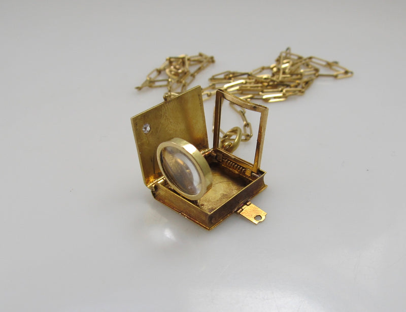 MUST SEE!  Antique locket with a magnifier and picture frame