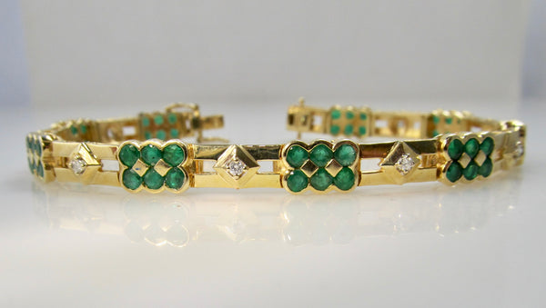 14k yellow gold line bracelet with emeralds and diamonds