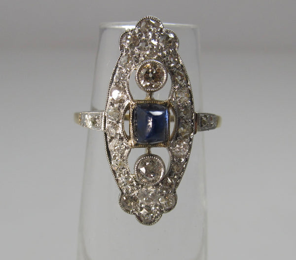 Navette shaped sapphire and diamond ring, 14k and platinum