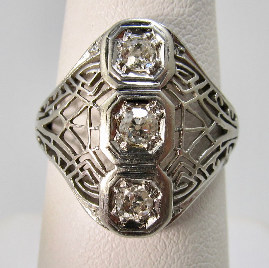 Antique white gold filigree diamond ring
