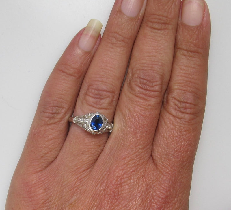 Filigree ring with a sapphire and diamonds