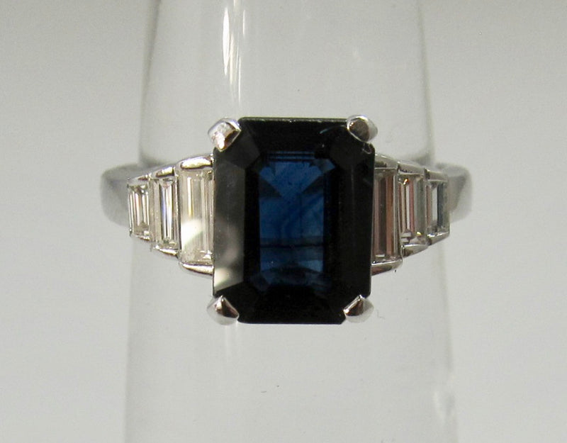 Emerald cut sapphire and diamond ring
