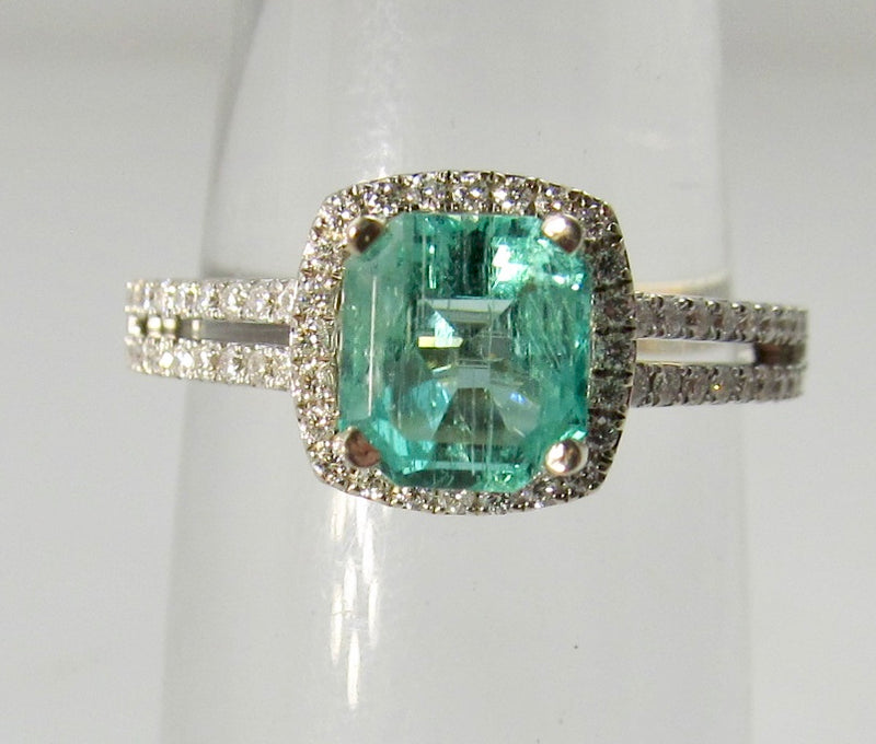 Modern 1.10ct emerald and diamond ring