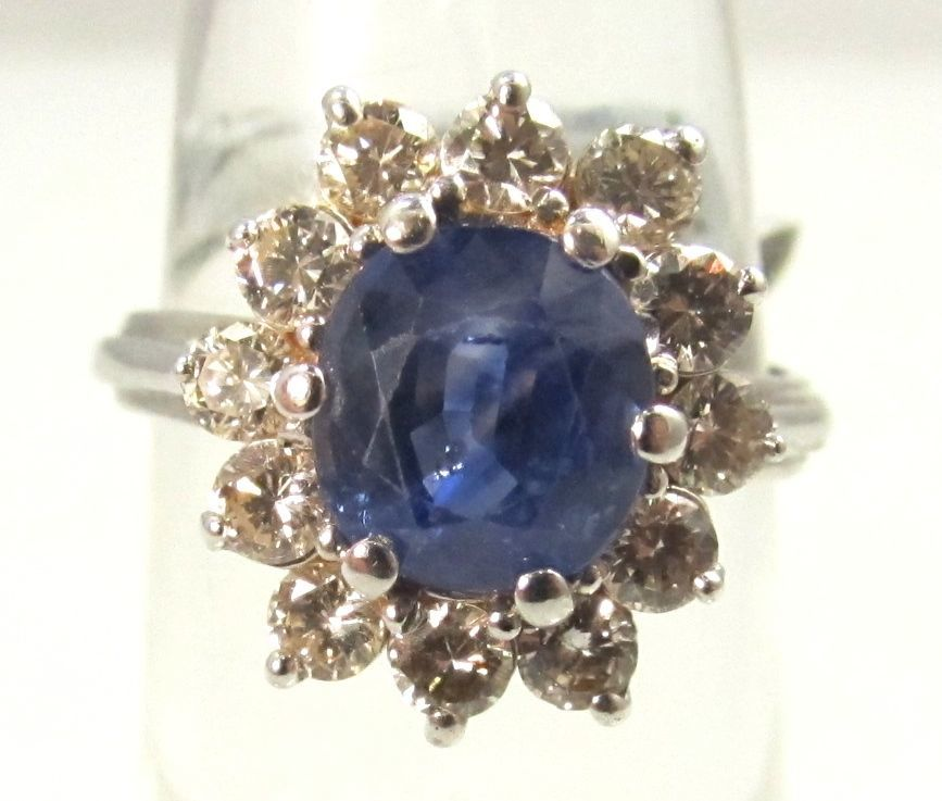 14k white gold ring with a 2ct sapphire and 1.25ct diamond ring.  Diamonds are VS2-SI1, G-H