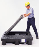 Removable grating on spill pallet for 4 drums