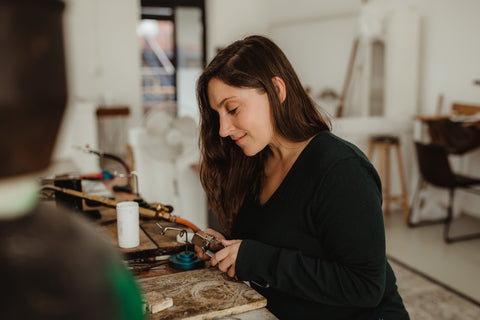 Claire hand crafting jewellery at a local studio