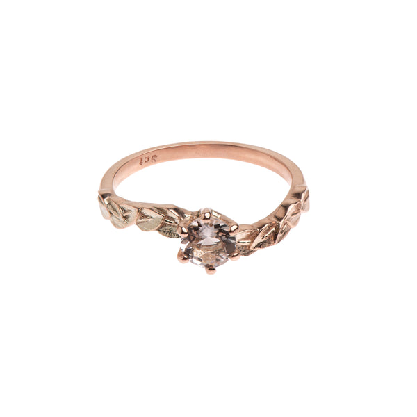 Rose gold and morganite engagement ring with delicate leaf detail