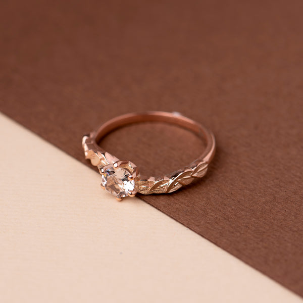 Rose gold ring with leaf motif and blush morganite set in a six claw setting