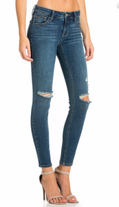 Medium wash knee tear jeans