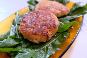 Salmon burgers on a bed of greens. Frywall splatter guard keeps the grease off your stovetop.
