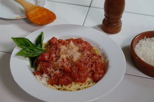 Red sauce, simmered with Frywall splatter guard.