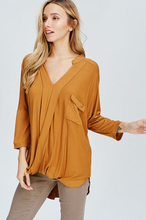THE ESSENTIAL TRANSITIONAL TOP