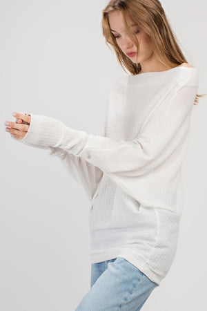 THE ESSENTIAL LIGHTWEIGHT ASYMMETRIC TOP