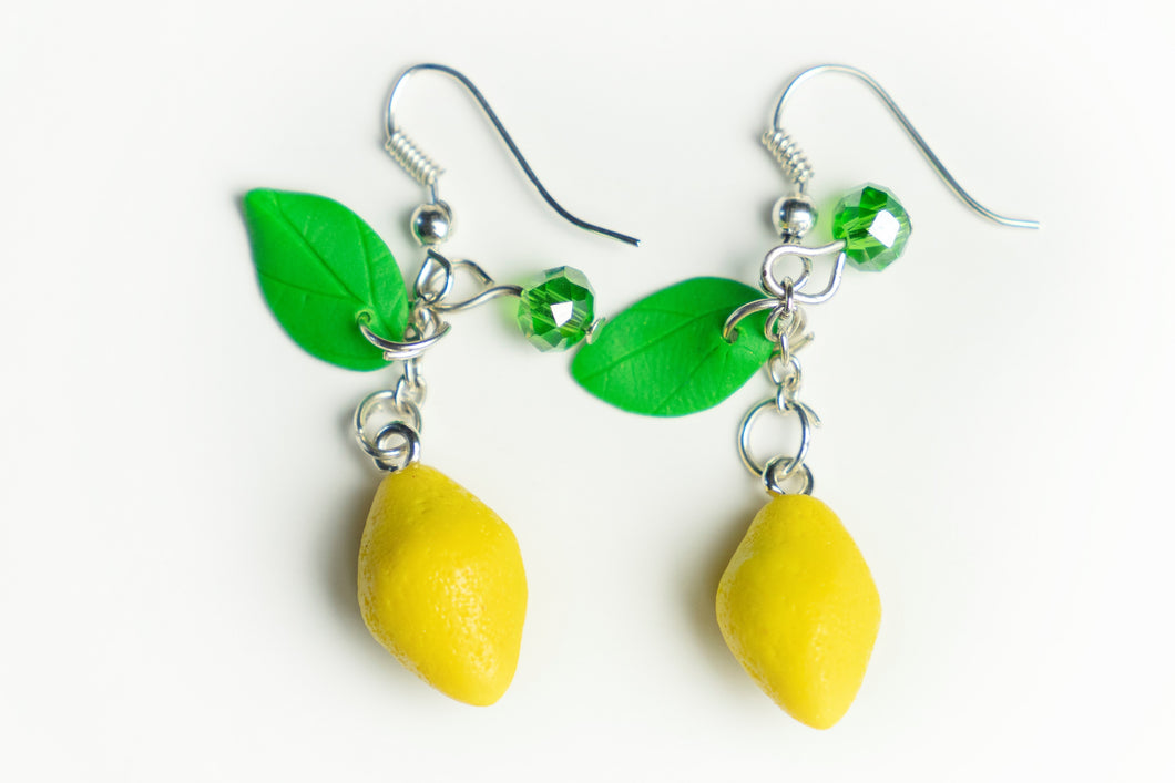 Beautiful handmade polymer clay lemon earrings. Food series.  By Lora's Treasures.