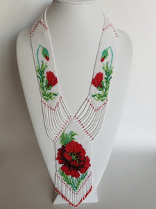 "Beaded necklace ""Gerdan"" Poppy on white background"