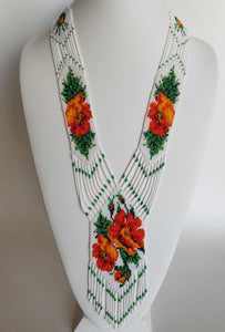"Beaded necklace ""Gerdan"" Orange flowers on white background"
