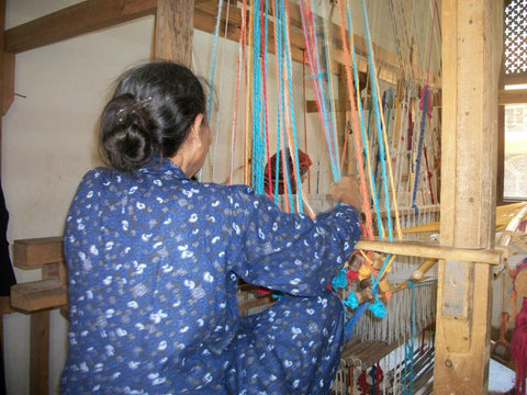 Akhmim - Woman weaving on horizontal loom