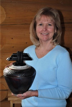 Christine Davis with a piece of her Raku pottery