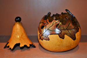Gourd, wood-burned, hand painted with oak leaf pattern and removable lid (with a buckeye topper!) by Debra Flagle
