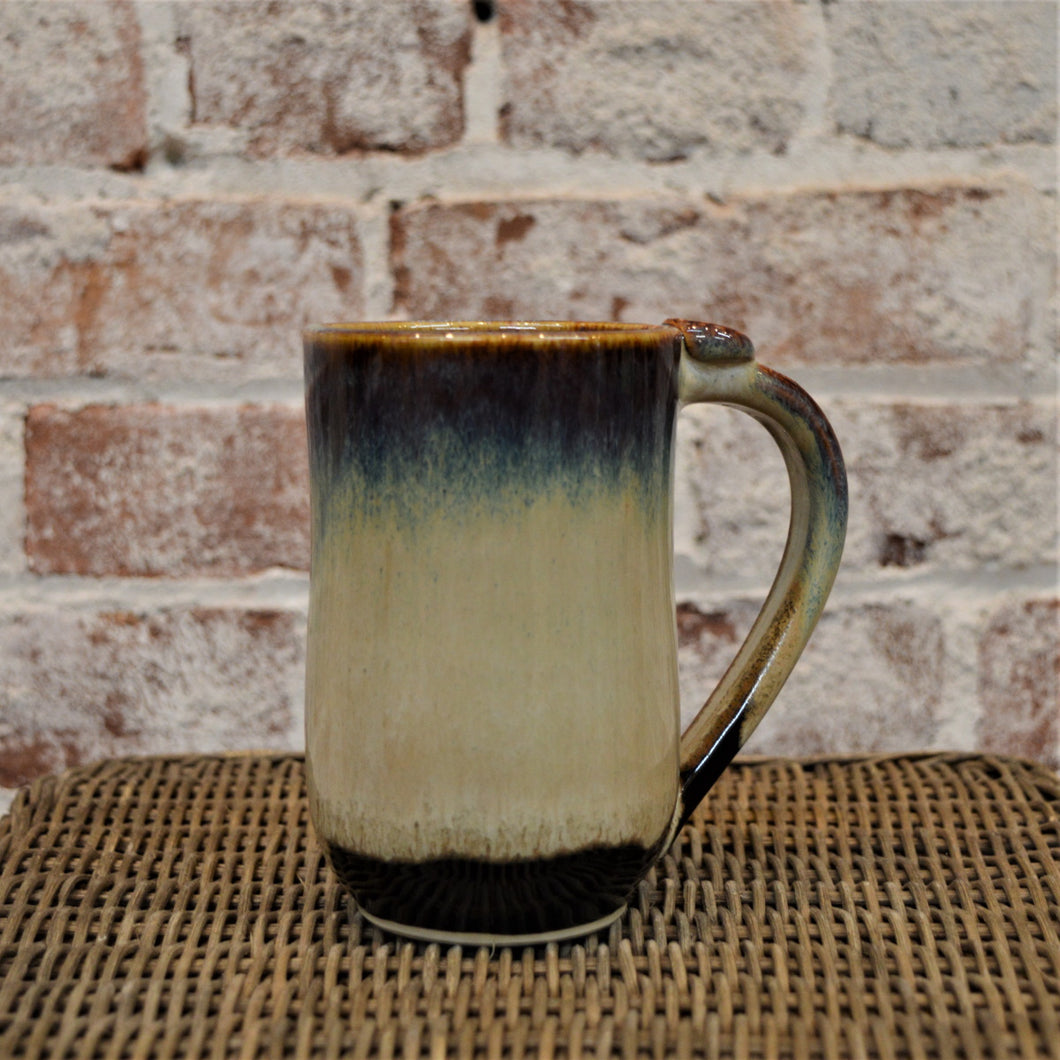 Tall ceramic mug by Hannah Martin (Earth Glaze)