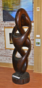 Infinity & 1/2 (walnut) by James Alexander Thom