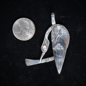 Sterling silver bird pendant with coin for size reference by by Tim Terry
