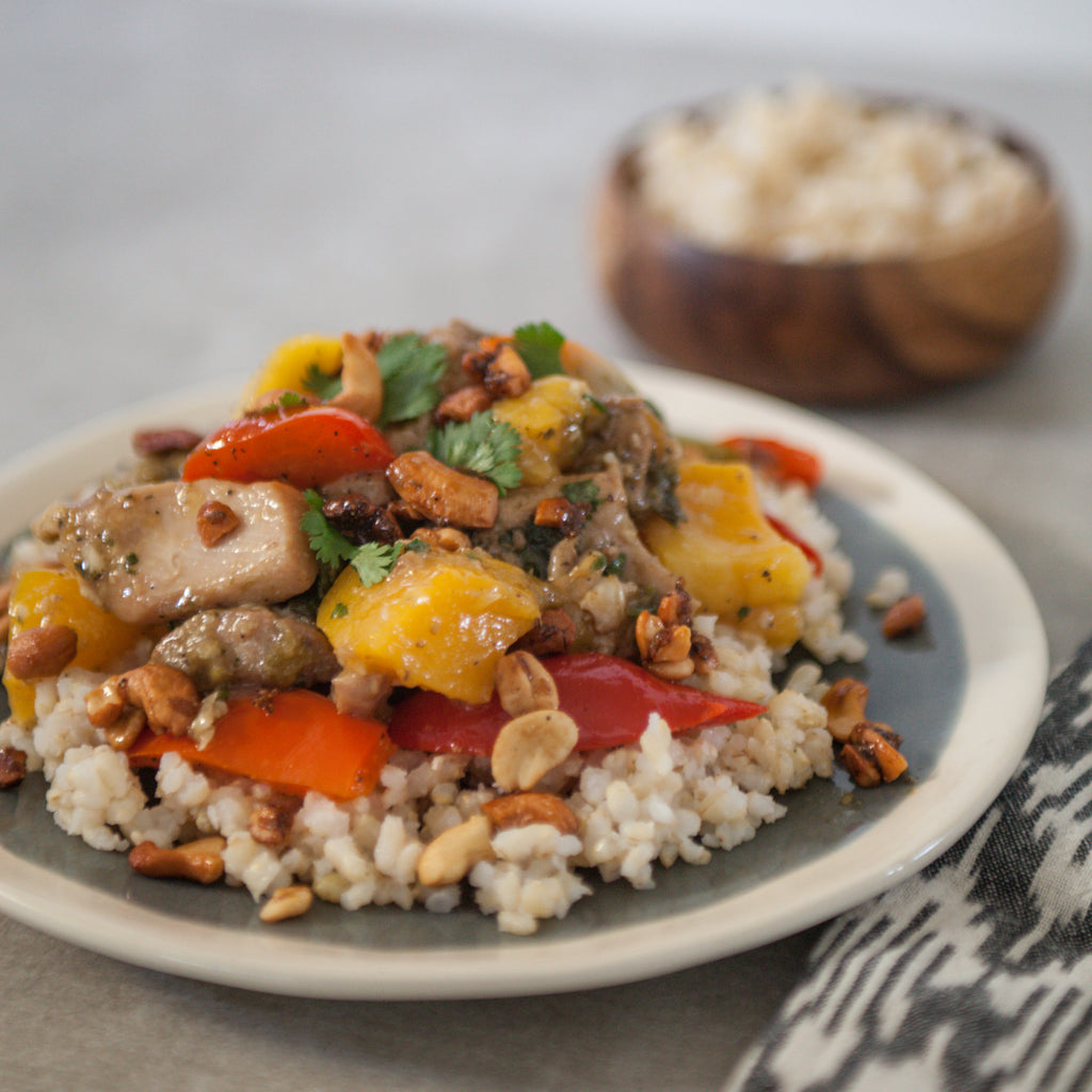 Black Pepper Chicken Thighs w/Mango, Rum & Cashews