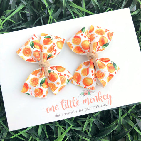 Oranges RAEGAN Bows - Set of 2 Piggy Clips