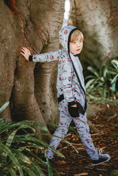 boy wearing aster and oak chameleon print hoodie cardigan and pants with black and white sneakers