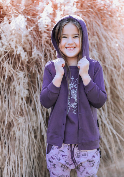 girl wearing aster and oak organic cotton purple hoodie cardigan with tee tshirt long sleeve top and pants girls clothing autumn and winter