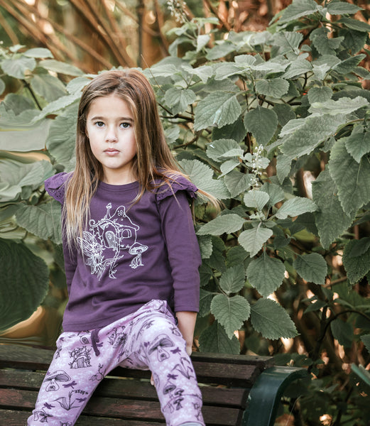 girl wearing aster and oak organic cotton long sleeve top tee shirt and pants purple girls clothing
