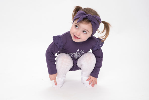 Cute girl wearing Aster & Oak Organic Cotton Topknot Headbad - Berry and fairy garden flutter tee