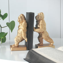 Load image into Gallery viewer, gold gorillas holding up a book gold home decor shelf decor