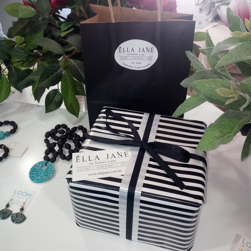gift wrapping service black and white wrapping paper and paper bag