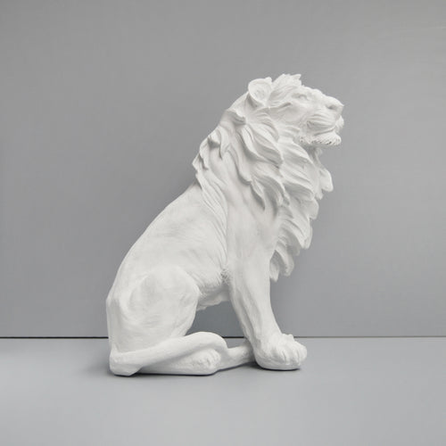 white lion statue sitting on a grey background made from resin  a concrete lion guardian alternative white moose australia