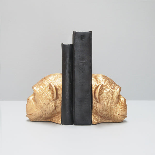 side view gold monkey head resin bookends with black books book lovers home decor