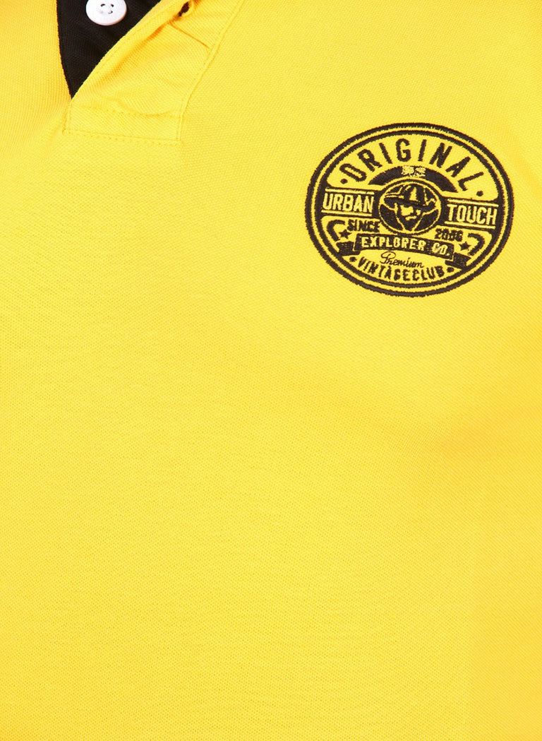 The classic yellow polo with black contrast