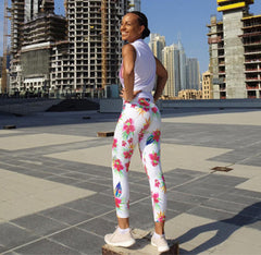 Woman wearing floral leggings surrounded by buildings