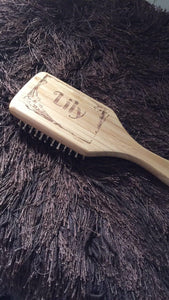 Wooden engraved hair brush