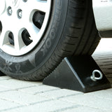 Image of wheel chock behind truck tire