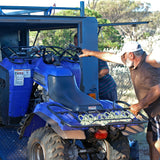 Image of man loading ATV on truck using e track o ring tie down anchors